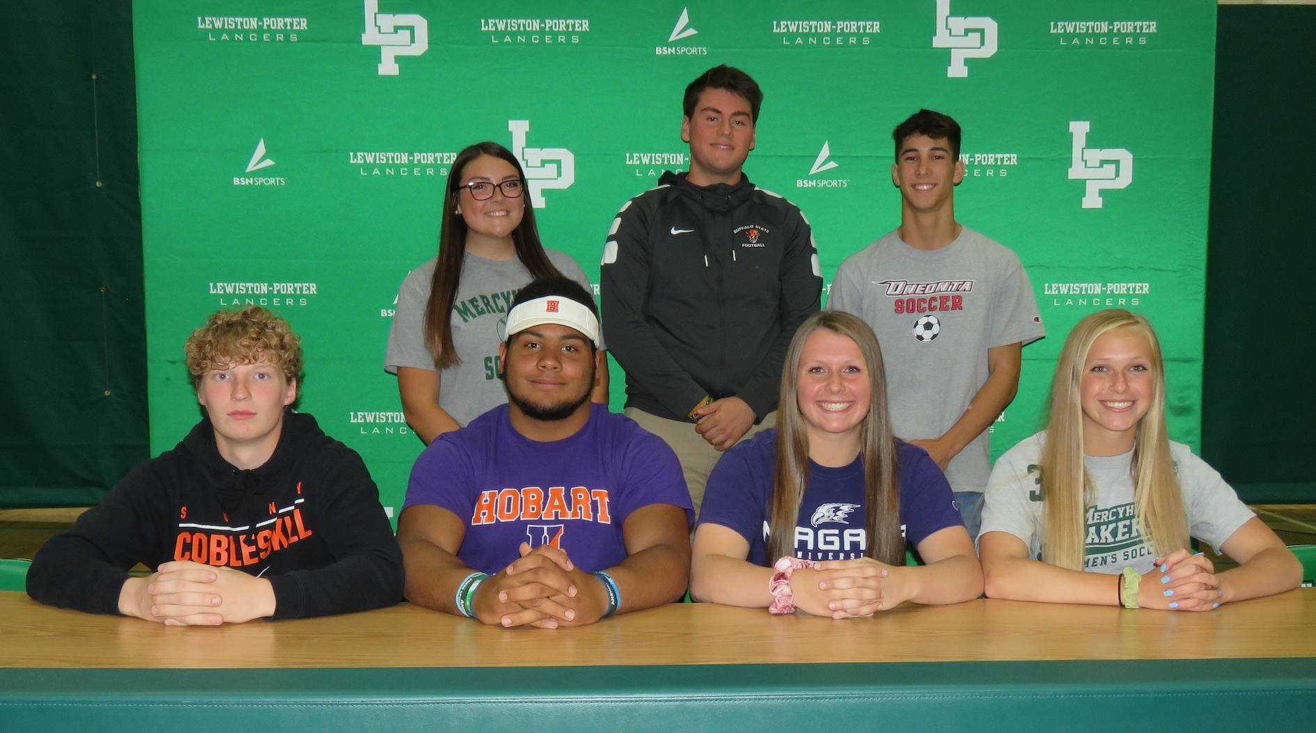 Seven Lewiston-Porter Lancers student athletes signed letters of intent to continue their careers in college on Thursday. From left, front row, Tanner Reisman, Joe Powers, Riley Crum and Alexis Lindamer. Back row, Larissa Reid, Aidan Salick and Jake Westadt. (Photos by David Yarger)