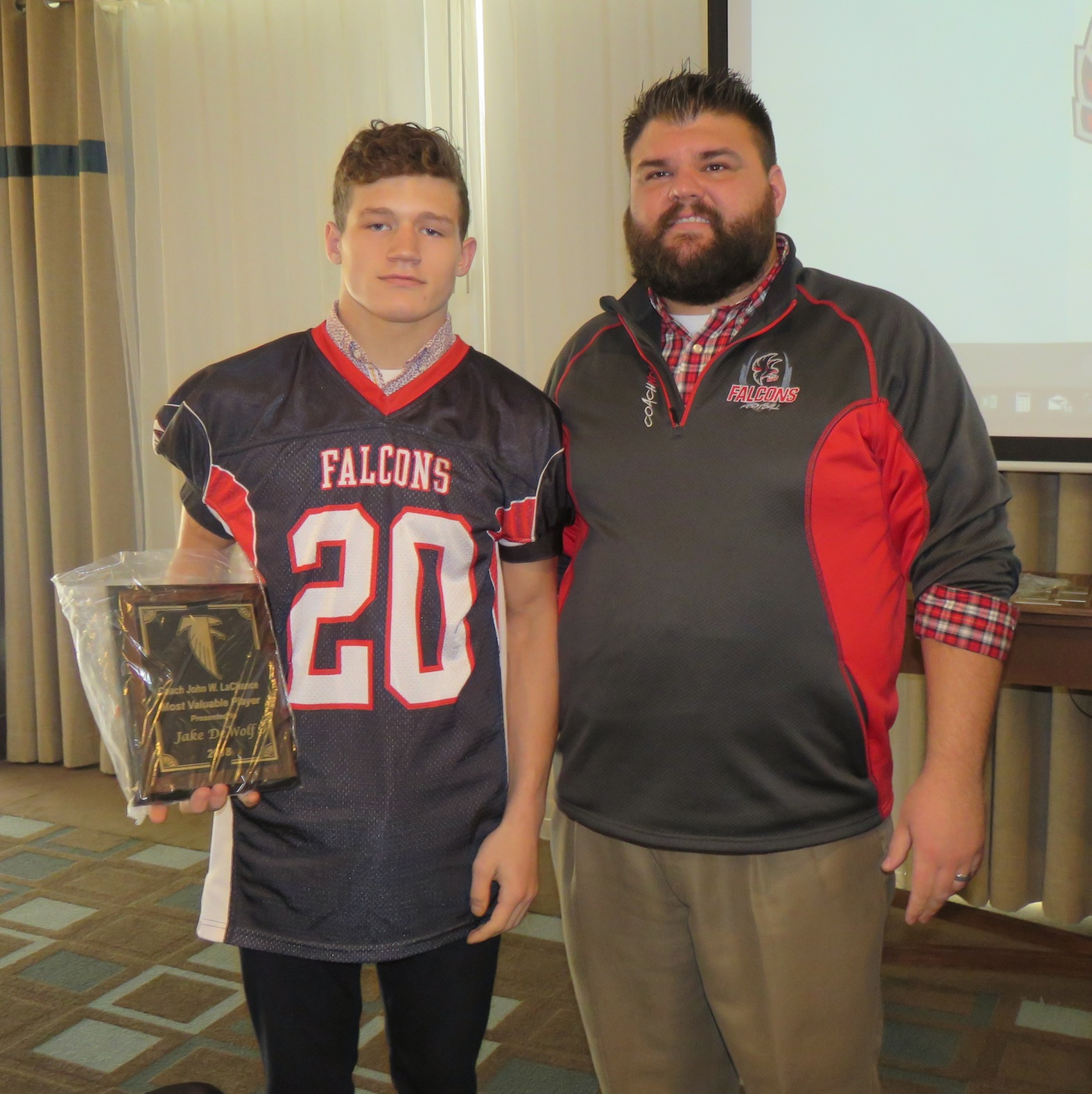 Jake DeWolf, left, is pictured with Falcons coach Russ Nixon after receiving the 2018 Coach John W. LaChance Most Valuable Player award. (Photos by David Yarger)