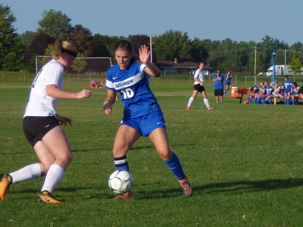 Grand Island's Ana Mascaro and Wheatfield's Erin Weir fighting for possession.