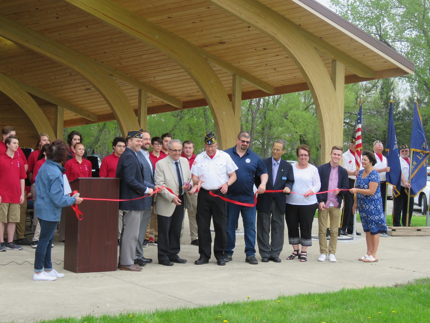 From left, Parks and Recreation Director Patty Brosius, Sen. Rob Ortt, Eighth District Legislator Richard Andres, North Tonawanda Mayor Art Pappas, Alderman Robert Pecoraro, Alderman Eric Zadzilka, Alderman Mark Berube, Alderman Donna Braun, Alderman Austin Tylec and Pam Hogan of the Parks and Recreation Department cut the ribbon to the brand new band shell. (Photo by David Yarger)