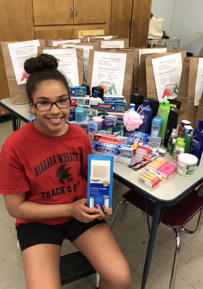 Mariah Rice and the essentials she gathered for fellow classmates.