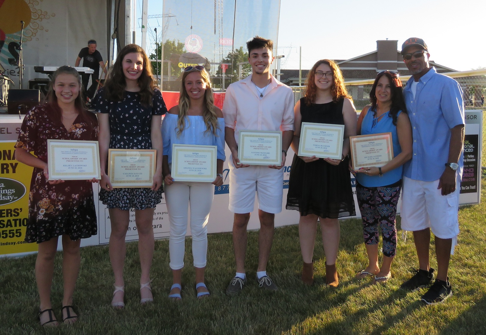 From left, Kelsey Lachowski, Callista Zayatz, Amanda Waliszewski, Santino Manzare, Teresa Buchner, and Lisa Sanders and Michael Sanders Sr. (the parents of Michael Sanders Jr.). (Photo by David Yarger)