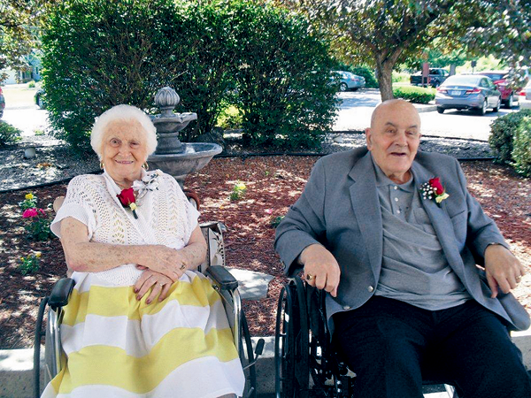 Tom and Rose Giangreco relax near the front garden at Northgate Health Care Facility in North Tonawanda before heading off to an anniversary dinner at one of their favorite restaurants. (Photo courtesy of Northgate)