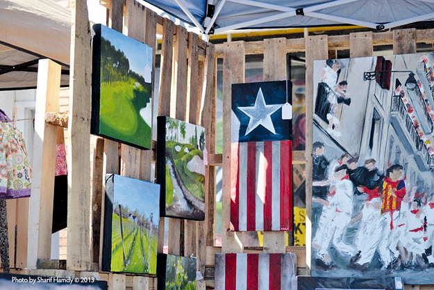 Scenes from the first Project 308 Art Festival in 2013 are shown. The third annual festival will take place Sept. 26 on Oliver Street in North Tonawanda. (Photos courtesy of Sharif Hamdy)
