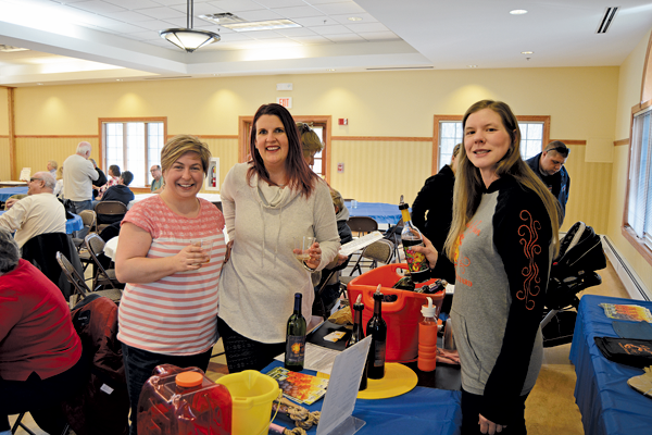 Cristin Lingle (left) and Beth Henderson of Wheatfield partake in a wine tasting provided by Shane Gustafson, owner of A Gust of Sun Winery & Vineyard.