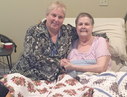 Niagara Hospice social worker, Cheryl Ferguson (left) and Niagara Hospice House resident Linda Culliver display two of the hand-crocheted blankets they worked on together that will be donated to other Niagara Hospice House residents. Anyone interested in donating lap blankets for comfort totes are asked to bring them to Niagara Hospice from 8:30 a.m. to 4:30 p.m. weekdays.
