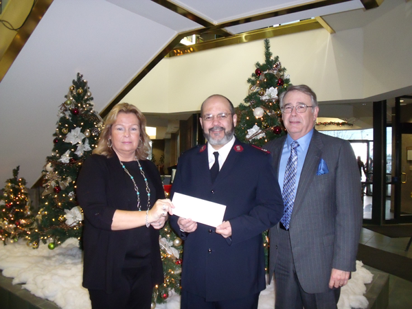 Pictured, from left: Susan Rohring, Major Jose Santiago of the Lockport Salvation Army, and Robert Pfeil.