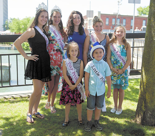 The winners of the 2015 Canal Fest pageants are shown July 19 on the opening day of the festival. In the back row, from left, are Queen Cara Porto, Teen Princess Emileigh Mazurkiewicz, pageant Director Dana Fischer, Junior Princess Olivia Kemna and Little Princess Savannah Valentine. In the front row, from left, are Tiny Princess Maria A. Mis and Little Mister Braxton Vailancourt. (Photo by Karen Gioia; click for a larger image)