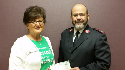 Pictured, from left: Nancy Baes of Cornerstone and Maj. Jose Santiago of the Lockport Salvation Army.