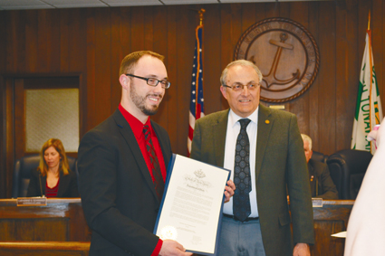 Mike Zimmerman (left) receives a proclamation from Mayor Art Pappas.