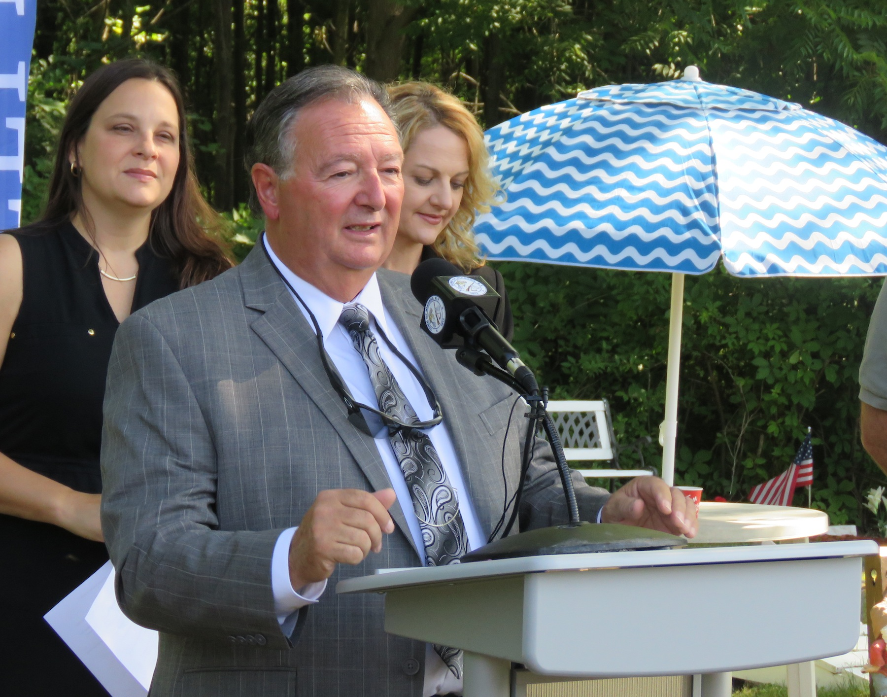 Town of Niagara Supervisor Lee Wallace speaks at Thursday's announcement. Wallace spent over three years looking for ways to restore Cayuga Creek and help alleviate some of the flooding issues around Tuscarora Road and Roberts Drive. (Photo by David Yarger)