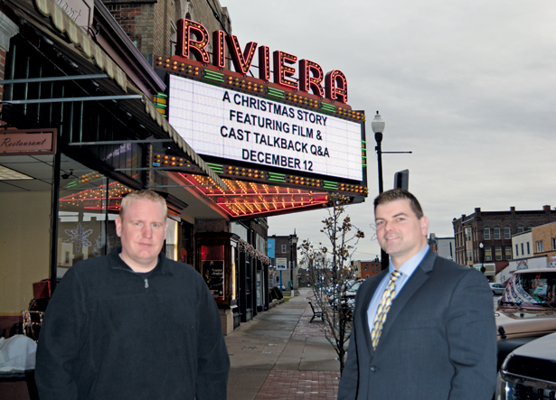 Joe Lavey Jr., left, co-owner and promoter of Carousel Promotions LLC, stands with director of development for the Riviera Theatre Gary Rouleau, in front of the theater's marquee displaying `A Christmas Story.`