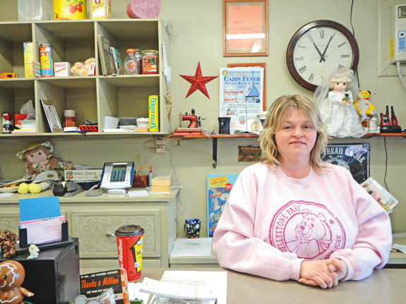 Sanborn Mill Co-op owner Cori McKinstray-Michalak behind the counter at her new business.