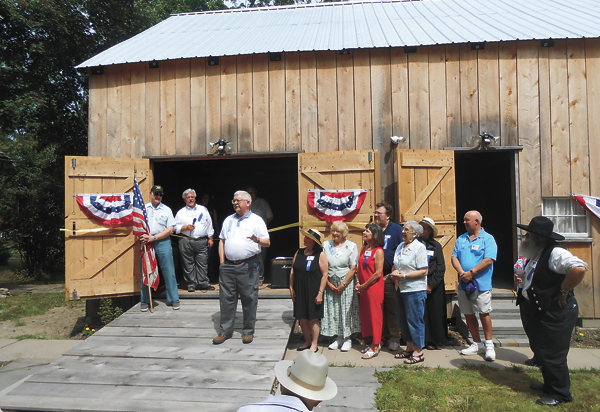 Town of Wheatfield Supervisor Robert B. Cliffe speaks to attendees at the grand opening event held at the Das Haus, Einhaus, und Der Stall German Heritage Museum.