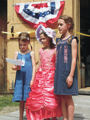 Granddaughters of the society's founder, Eugene Camann, recite a prayer at the Das Haus, Einhaus, und Der Stall German Heritage Museum's new Einhaus house-barn.