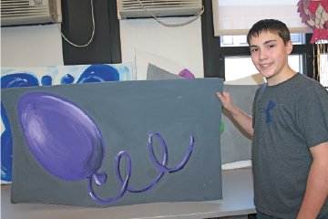 Peter Buffone shows off his artwork for the Gliding Stars show `Colors of the Rainbow` on March 28 and 29.