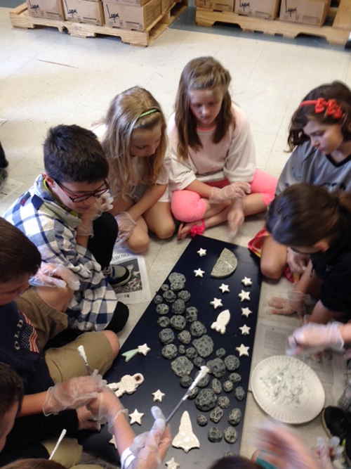 Third-graders glue imagery they created to panels for their outdoor sculpture during art class at Errick Road Elementary School. From left are Ryan Bergstrom, Kevin Andrews, Samantha Pignato, Allison Failing, Sara Maghrak and Gianna Scarpelli.