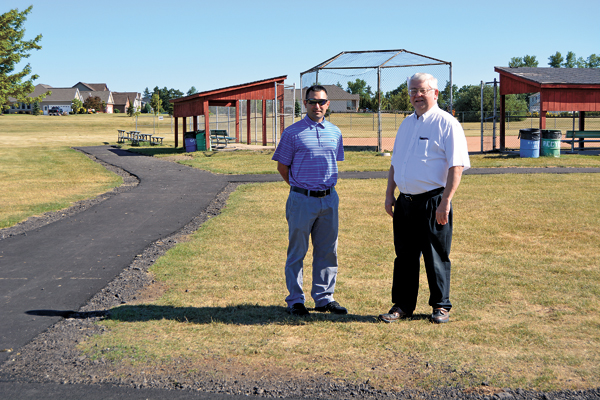 Town of Wheatfield Recreation Director Mike Ranalli (left) stands with Supervisor Robert B. Cliffe beside a new path leading to one of Fairmount Park's ball fields.