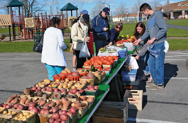 Visitors shop for local fruits and vegetables from Skurski Farms.