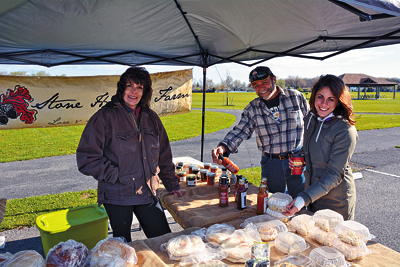 Shown is Margaret Darroch (left) representing Stone Hallow Farmers at the Town of Niagara Farmers Market. At right, are, Town of Niagara parks employee Roger Spurback and Town Recreation Department employee Mia Fontanarosa. (Photos by Marc Carpenter)