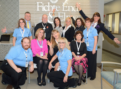 Staff members of Fichte Endl & Elmer Eyecare pose for a group shot at the grand opening celebration for their new facility on Porter Road.