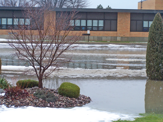 At Errick Road Elementary School, where water can drown the parking lot and flow all the way to the building, flooding is not only a drainage issue, but also a safety concern. This 2008 photo by Joe and Sharon Downie shows the school has faced this issue for many years.