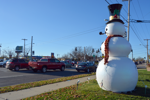 Frosty Niagara looks on at a bustling Military Road.