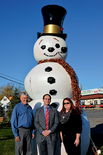 Town of Niagara Business and Professional Association President Anthony L. Restaino (center) stands with Frosty Niagara project participants David Dorato of Cecconi's Joe Cecconi's Chrysler Complex and Janelle Zasucha of the Greater Niagara Federal Credit Union.