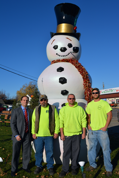Members of the Town of Niagara's Highway Department assembled Frosty Niagara last week on Military Road. From left, are, Town of Niagara Business and Professional Association President Anthony L. Restaino, Jim Scalzo, Jim Scalzo Jr. and Dave Haseley of the Town of Niagara Highway Department.