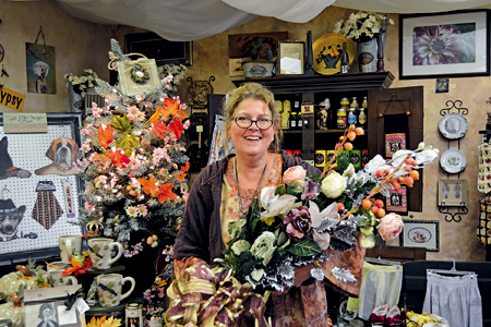 Holly Rankie, owner of Hip Gypsy on Webster Street, displays decor she is placing in her storefront for Winter Walk, made by one of her customers, Maria Waselus of North Tonawanda.