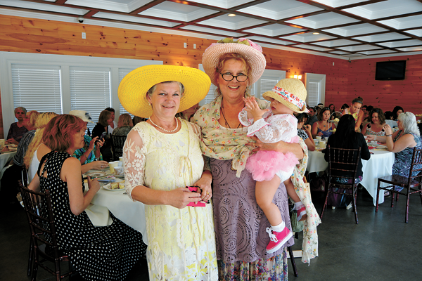 Michele Krienbuhl (left) stands alongside fellow businesses owner Holly Rankie, who is holding her granddaughter, Gwyneth.