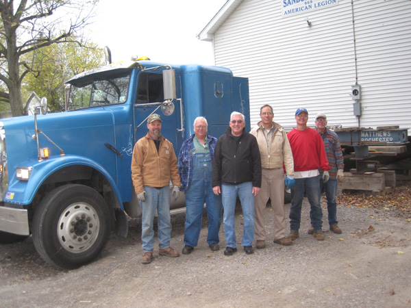 Matthews House Movers and Bill Sterner, chairman of the project (third from the left) start the move.