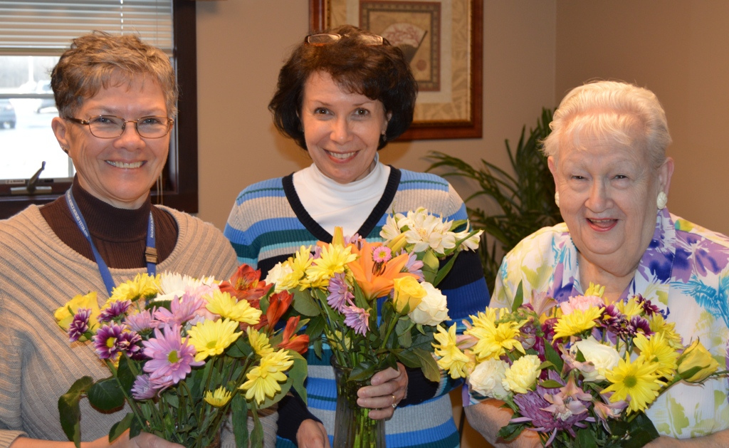 Niagara Hospice Mary Dixon (left), Karen Feger and Sylvia Cooper `think spring` as they help prepare for the annual Niagara Hospice spring bouquet sale.