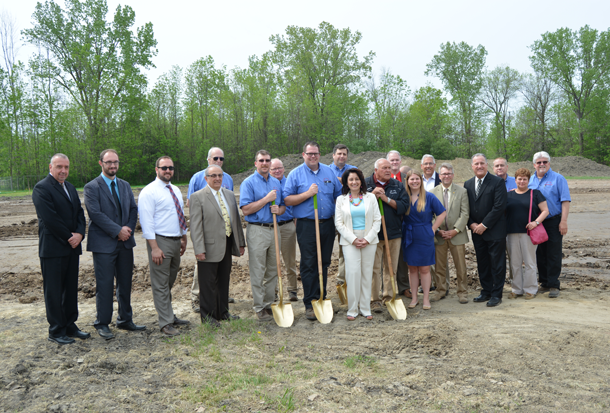 Ivy Lea Construction administrators, along with local officials and supporters, break ground at the company's new site at 765 Walck Road, North Tonawanda. (Photos by Lauren Zaepfel)
