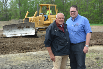 Ivy Lea Construction president Michael Washington (right) stands with his father, John Washington (founder of the business), at their company's new site, currently under construction.