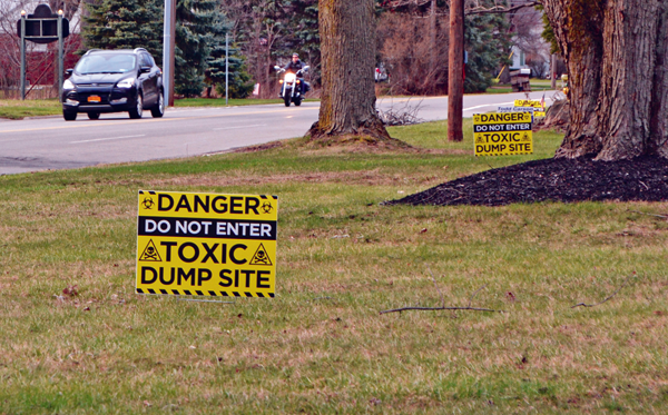 Signs placed on residents' lawns near the Niagara Sanitation Landfill warn of toxins.