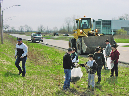 Volunteers, including Cub Scouts and town officials, participate in a past Liberty Drive Cleanup event.
