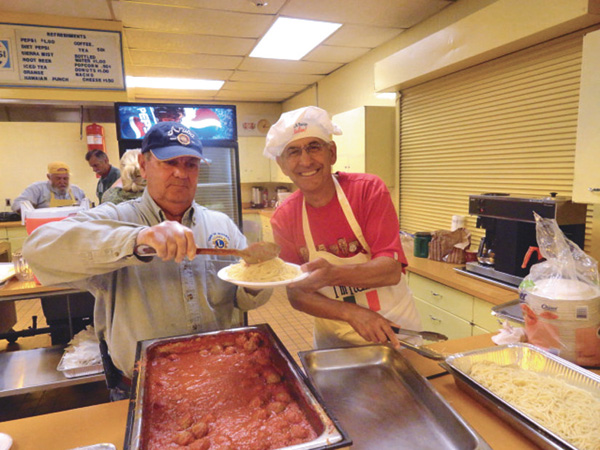 Pictured, from left, are Lions Jim Greig and Angelo Onevelo serving a spaghetti dinner at last year's event.