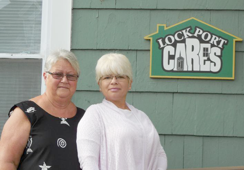 Newfane's Margaret Brant, 71, left, and Ruthy Warda, soon to be 54, are shown in front of Lockport CARES shelter. They will walk across New York next month.