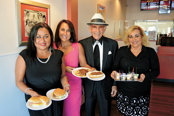 Business owner Louie Galanes stands with his daughters as they display some of the popular dishes available at Louie's Texas Red Hots. From left are, Argyrie Galanes, Vaso Kroto, Galanes and Stacy Galanes.