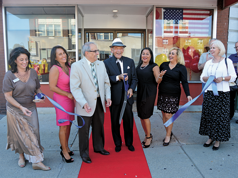 Louie Galanes cuts the ribbon during the grand opening of the new Louie's Texas Red Hots location at 18 Webster St., North Tonawanda.