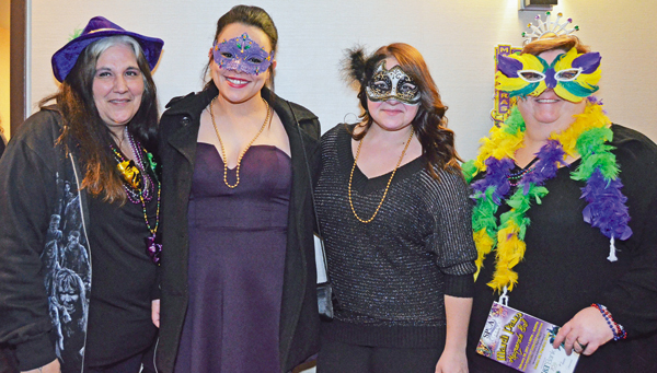 Eventgoers and Niagara County SPCA staff members enjoy the first Mardi Paws Masquerade Ball held on Fat Tuesday. From left, are Janelle Harris, Dominique Keller, Lauren Zaninovich and Stacy Rainey. (Photos by Kristen Musick-Cake)