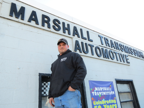 Frank Manarino stands in front of Marshall Automotive & Transmission.