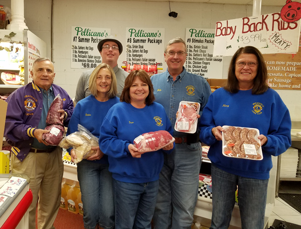 Niagara-Wheatfield Lions Club members hold a variety of meats offered at Pellicano's Marketplace. Standing, from left, are Second Vice President Bill Ross, event co-chair Deb Carr, Corey Pellegrino of Pellicano's Marketplace, Lion Fran Boore, First Vice President Walt Garrow and event co-chair Nancy Rosie.