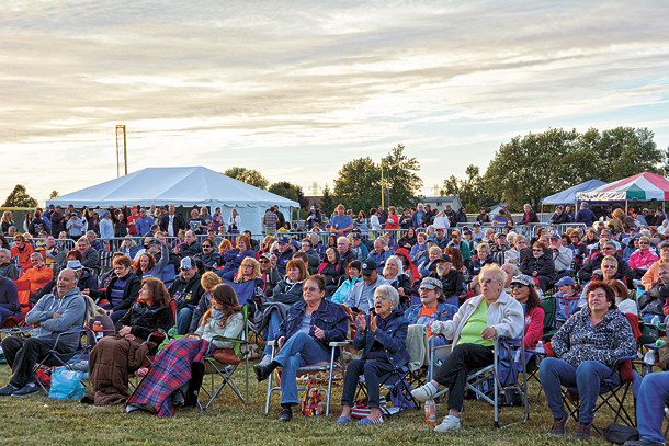Concertgoers gather to watch the first performance of the Music Mania Mondays series in Veterans Memorial Community Park. (Photo by Marc Carpenter)