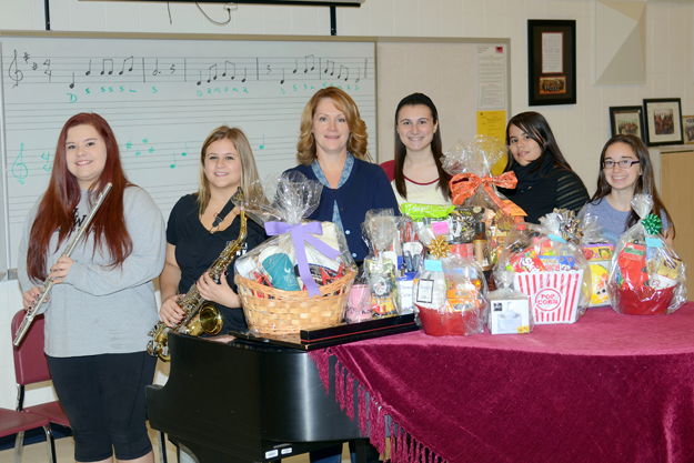 Niagara-Wheatfield students, along with their teacher Christine Riederer, display prizes for a fundraising event to be hosted by the Music Parents Club. From left: Jordan Robinson, Julia Shapiro, Riederer, Sabrina Joseph, Meghan Luss and Abbey Weber.
