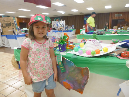 Mariana Martin, 5, of Sanborn shows off some of her craft items on display Friday at the Niagara County Fair. It's her first year as a 4-H Cloverbud.