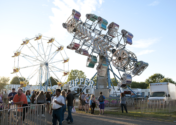 People walk through the midway at last year's Niagara County Fair. (File photo)