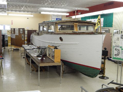 A 25-foot-long Little Giant cabin cruiser, made by the Richardson Boat Co. of North Tonawanda, is shown at the North Tonawanda History Museum.