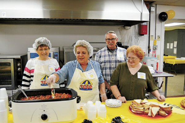 Volunteer Bobbie Seekins (far left) stands alongside Linda Finiki (center) as she stirs a pot of homemade chili for guests visiting Twin Cities Meals on Wheels Saturday. Also pictured are Twin Cities board member Gary Rockenbrock and Twin Cities Meals on Wheels Coordinator Pam Hill. (Photos by Lauren Zaepfel)